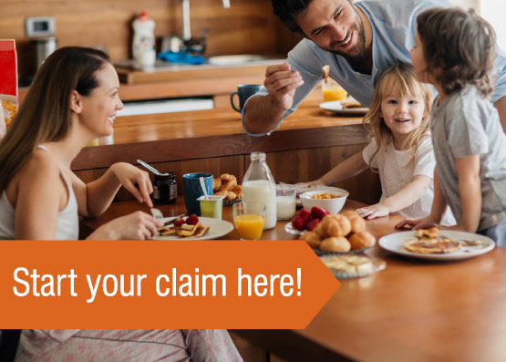 Photo of family at breakfast table - Start your claims here!